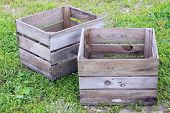 stock photo of wooden crate  - forgotten old rustic wooden crate in the yard - JPG