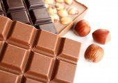 pic of hazelnut  - Black and milk chocolate bars with hazelnuts close up - JPG