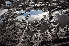 stock photo of boggy  - Mud and puddles on the dirt road - JPG