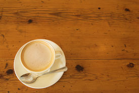 picture of wooden table  - a cup of coffee on a wooden table - JPG
