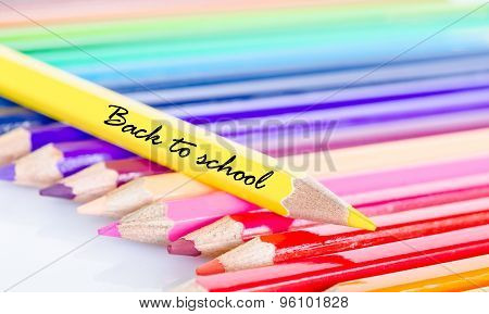 Colorful Pencil Crayons On A White Background.