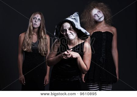 Three Halloween Personages Over Dark Background