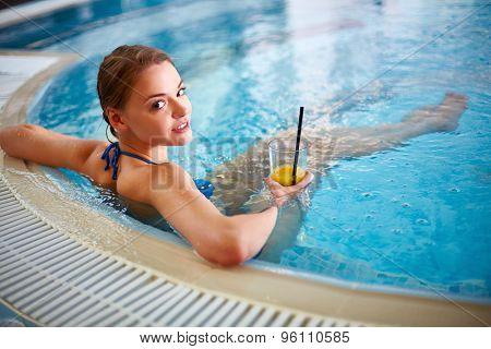 Attractive female in bikini relaxing in hot tub