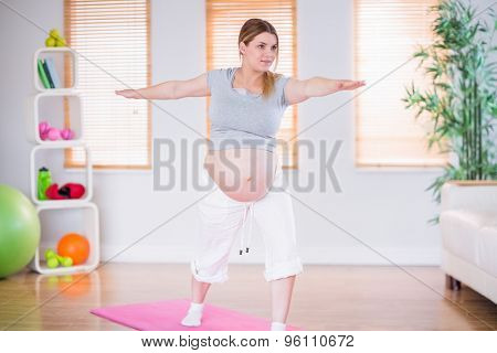 A pregnant woman doing exercise at home