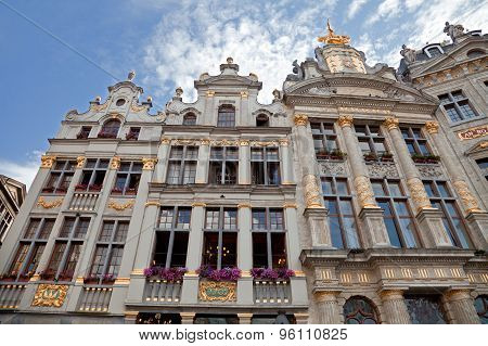 Historical Buildings Of Grand Place In Brussels Against Cloudy Blue Sky