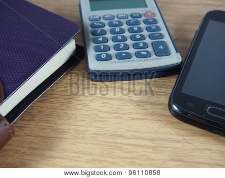 Business Accessories, Violet Notebook, Calculator,mobile Phone On Wood Background