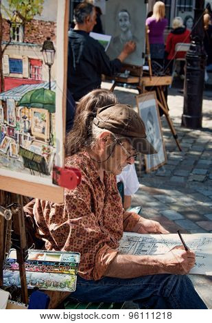 Local Artist At Work In Place Du Tertre Of Paris Montmartre