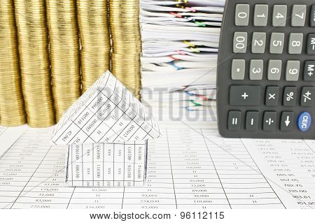 Close Up House On Finance Account With Overload Gold Coins