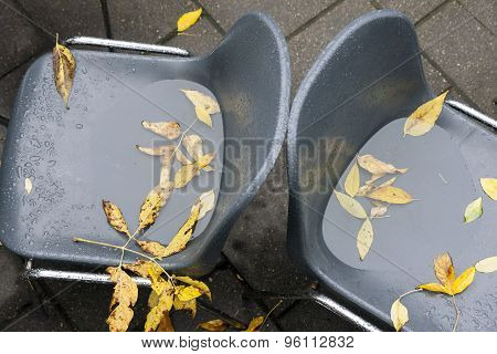 Two Abandoned Cafe Chairs At Fall