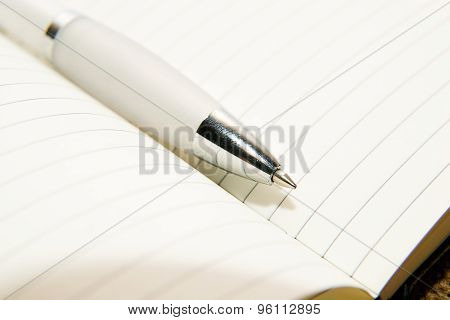 Notebook And Pen On The Old Tissue