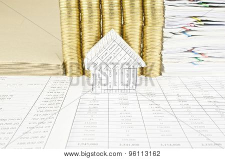 House In Front Of Pile Of Gold Coins