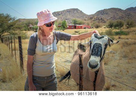 Woman with gemsbok