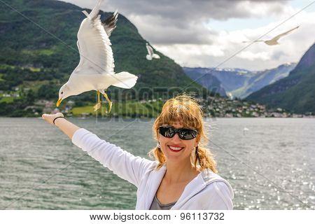 Woman enjoy seagull