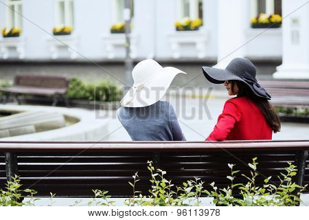 Old Fashioned Ladies Chatting On The Bench