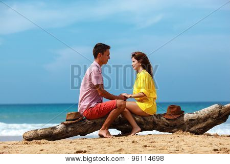 lovely couple sitting on log