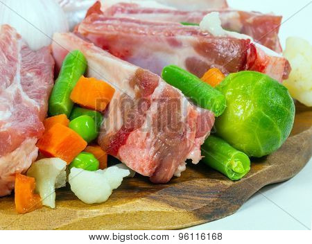 Uncooked Ribs, Meat And Vegetables. Fragment