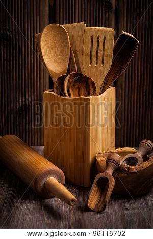 Wooden kitchen utensils on rustic wooden table