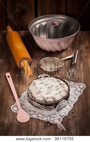 White and chocolate Christmas cake with baking utensils