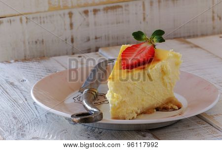 slice of cheesecake with strawberries lying on a plate