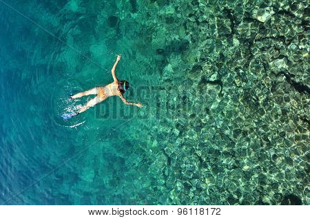 Sexy Woman Snorkeling In Tropical Sea