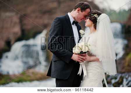 Lovely Newlyweds Background Waterfall At Cold Autumn Day