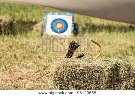 Straw archery target. Arrows and target on the haystacks, selective focus.