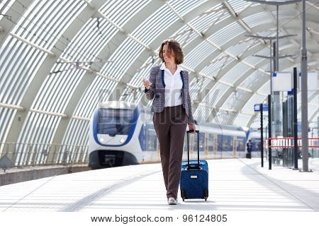Traveling Business Woman Walking With Bag And Phone