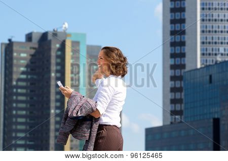 Business Woman Walking In The City With Mobile Phone