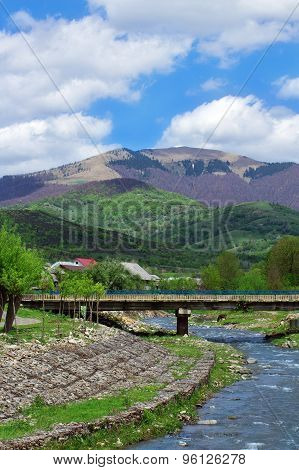 Landscape Of A River With Bridge Among Carpathians Mountains
