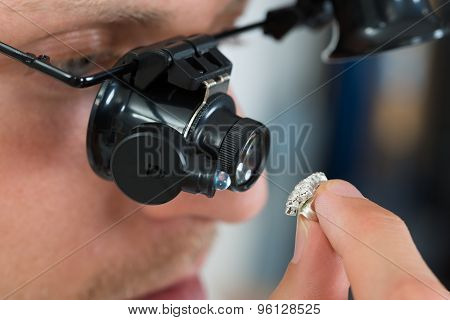 Jeweler Looking Ring With Loupe