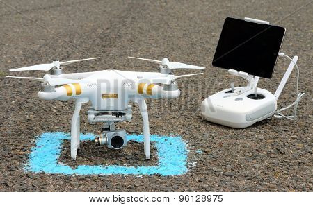 PILSEN CZECH REPUBLIC - JULY 16, 2015: Drone quadrocopter Dji Phantom 3 Professional with high resolution digital camera (High quality 4K). New tool for aerial photo and video.