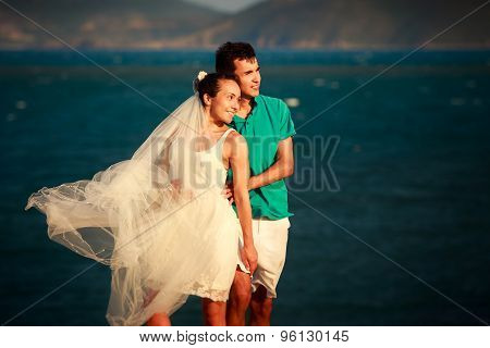 Girl In White And Guy Stand In Sunrays