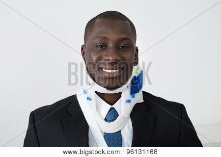 African Businessman With Neck Brace
