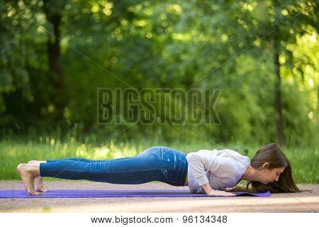 Chaturanga Dandasana Yoga Pose In Park Alley