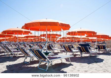 Umbrellas And Sunbeds In Cesenatico Beach, Italy