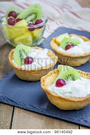 Homemade Tartlets With Whipping Cream And Fruits