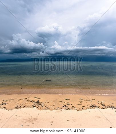 Storm clouds rising in tropical sand beach