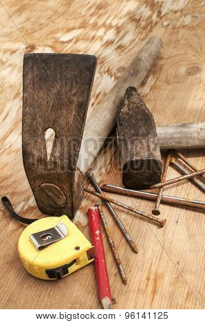 Hammer,adze,measuring tape,nails