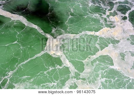 Green sea with waves and foam