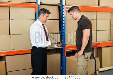 Manager And Worker In Warehouse