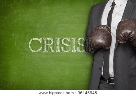 Crisis on blackboard with businessman