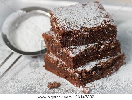 Brownie. Chocolate cakes with powdered sugar