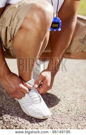 Fit Man Tying His Shoes