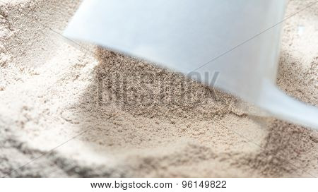 Isolate Protein Powder Chocolate Deluxe Flavour With Scoop Macro Closeup