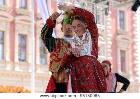 ZAGREB, CROATIA - JULY 17: Members of folk group Dubrovacki primorski svatovi from Gornja Sela, Croatia during the 49th International Folklore Festival in center of Zagreb, Croatia on July 17, 2015