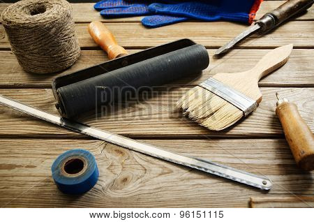 Work And Painting Tools On The Wooden Background. Horizontal
