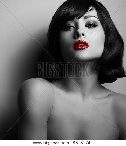 Hot Sexy Makeup Female Model With Red Lipstick And Black Hairstyle Posing. Closeup Portrait