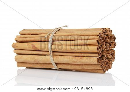 tied true ceylon cinnamon sticks, isolated on white