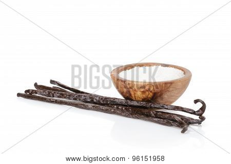 fresh bourbon vanilla pods and sugar, isolated on white