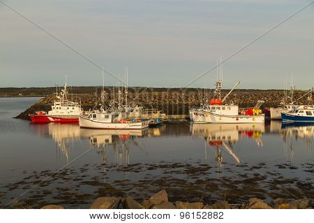 Fishing Fleet Reflecting In Calm Water